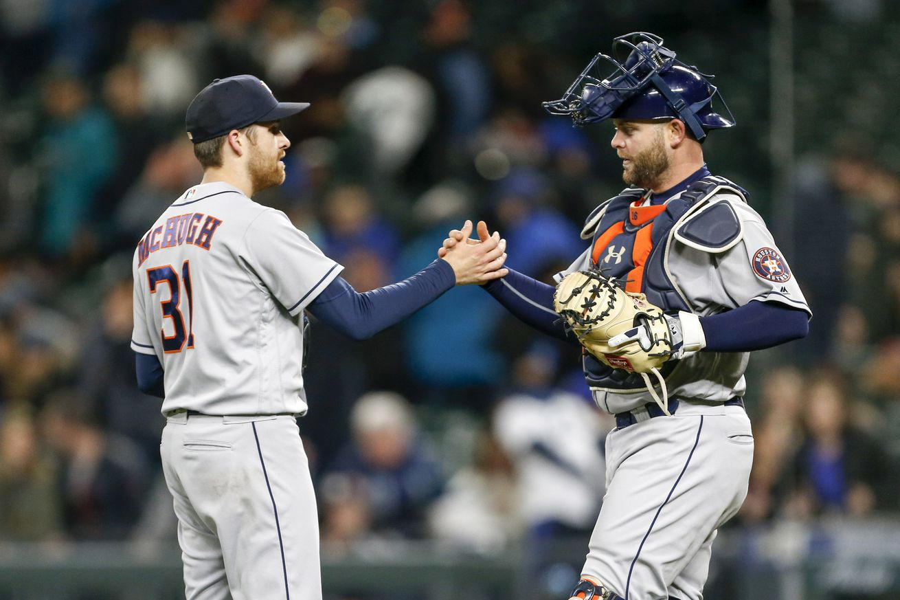 Apr 18, 2018; Seattle, WA, USA; Houston Astros relief pitcher Collin McHugh (31) greets catcher Brian McCann (16) following a 7-1 victory against the Seattle Mariners at Safeco Field. Mandatory Credit: Joe Nicholson-USA TODAY Sports