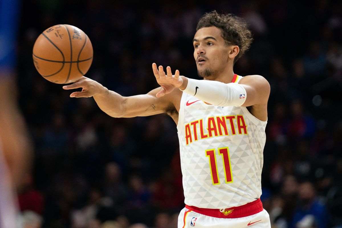 Atlanta Hawks guard Trae Young passes the ball against the Philadelphia 76ers during the first quarter at Wells Fargo Center.