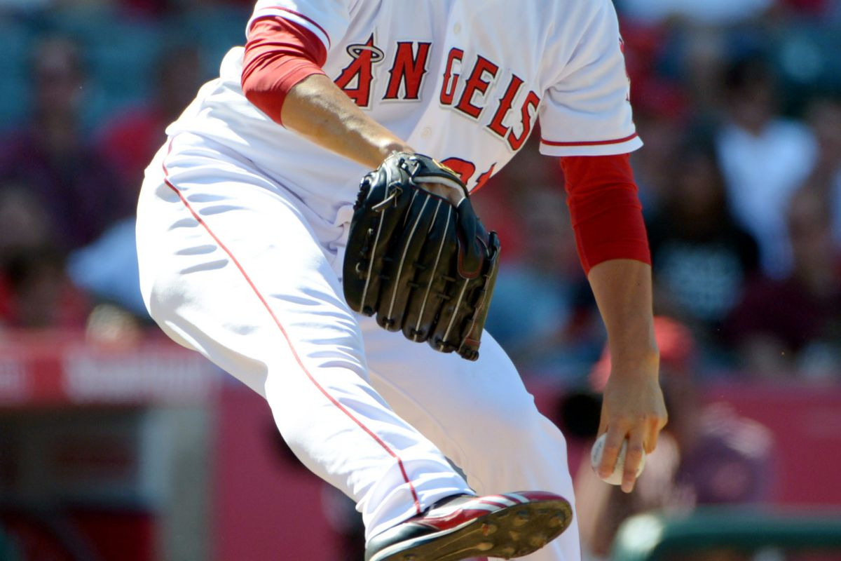 Jul 21, 2012; Anaheim, CA, USA; Los Angeles Angels reliever Hisanori Takahashi (21) delivers a pitch against the Texas Rangers at Angel Stadium. The Rangers defeated the Angels 9-2. Mandatory Credit: Kirby Lee/Image of Sport-US PRESSWIRE