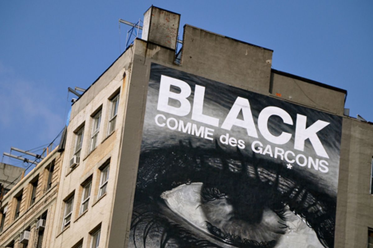 """CDG BLACK continues to loom over Houston Street.  Photo via <a href=""""http://www.flickr.com/photos/essgee/3755240230/in/pool-rackedny/"""">EssG</a>/Racked Flickr Pool"""