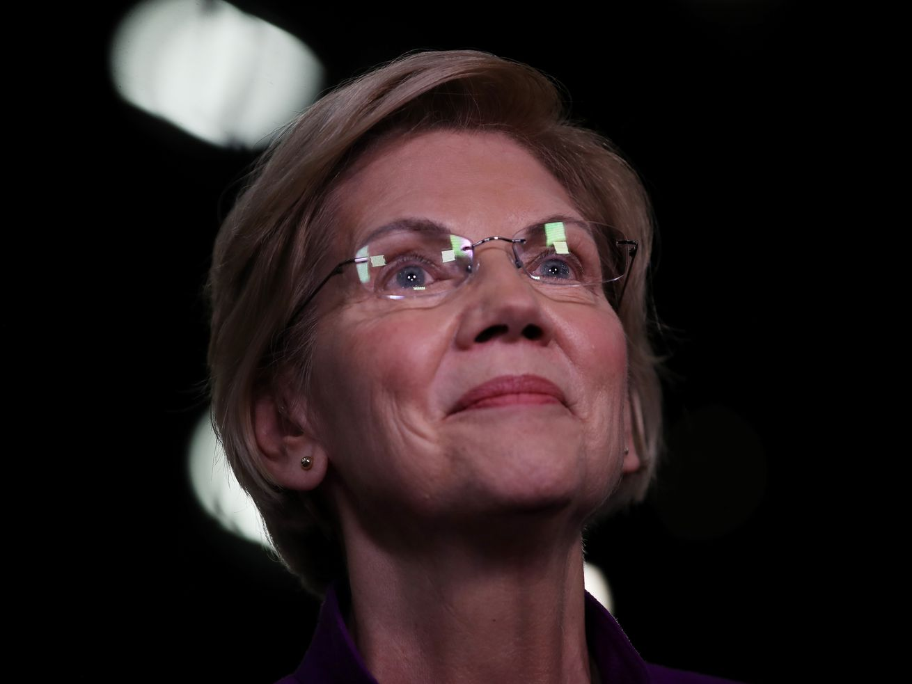 Sen. Elizabeth Warren (D-MA) speaks to the media in the spin room after the first night of the Democratic presidential debate on June 26, 2019, in Miami, Florida.
