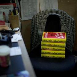 """Copies of the """"The Casual Vacancy"""" by author J.K. Rowling rest on a chair behind the sales counter to go on the shelves at a book store in London, Thursday, Sept. 27, 2012.  British bookshops are opening their doors early as Harry Potter author J.K. Rowling launches her long anticipated first book for adults.  Publishers have tried to keep details of the book under wraps ahead of its launch Thursday, but """"The Casual Vacancy"""" has gotten early buzz about references to sex and drugs that might be a tad mature for the youngest """"Potter"""" fans."""