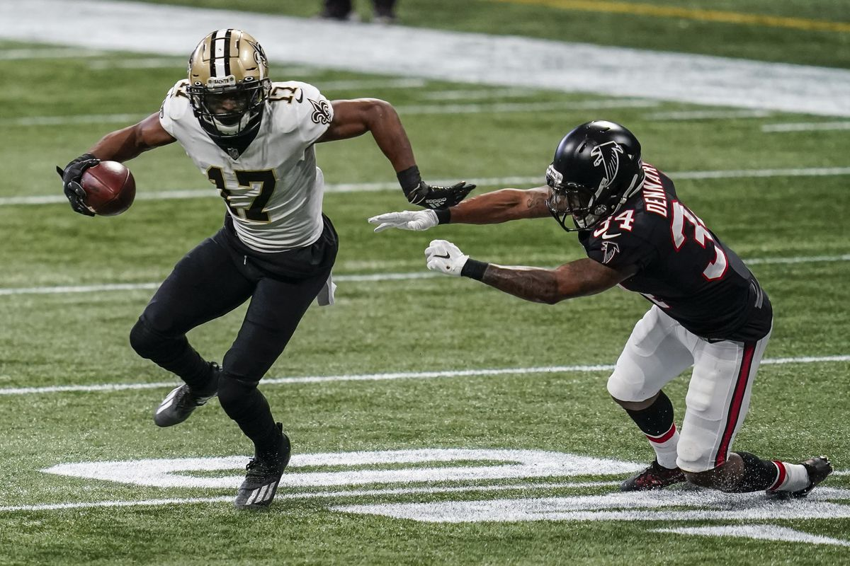 New Orleans Saints wide receiver Emmanuel Sanders (17) breaks a tackle by Atlanta Falcons cornerback Darqueze Dennard (34) during the first half at Mercedes-Benz Stadium.