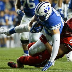 Brigham Young Cougars tight end Matt Bushman (89) is taken down by Utah Utes defensive back Chase Hansen (22) at LaVell Edwards Stadium in Provo on Saturday, Sept. 9, 2017.