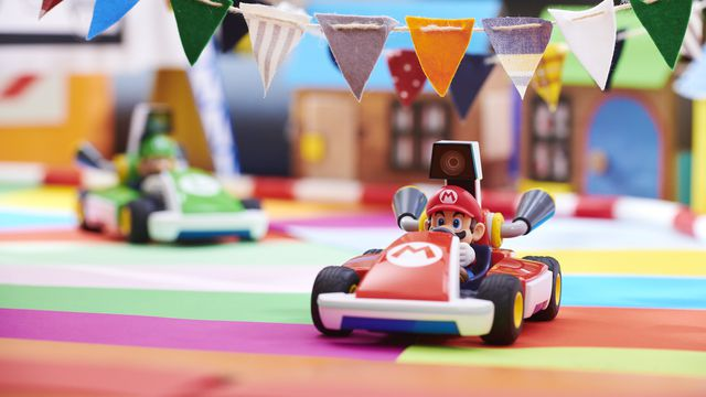 A photo of Mario's kart, with Luigi in the background, from Mario Kart Live: Home Circuit