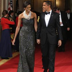 In a <b>Peter Soronen</b> dress and <b>Tom Binns</b> necklaces at Obama's first formal white house dinner with National Governors Association on February 22, 2009