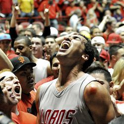 New Mexico's Drew Gordon, center, celebrates with the fans after an NCAA college basketball game against BYU on Saturday, Jan. 29, 2011, in Albuquerque, N.M.  New Mexico won 86-77 over 9th ranked BYU.