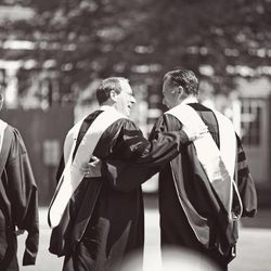 Mitt Romney and Congressman Bob Goodlatte walk together following Romney's speech at Southern Virginia University's commencement on April 27, 2013.