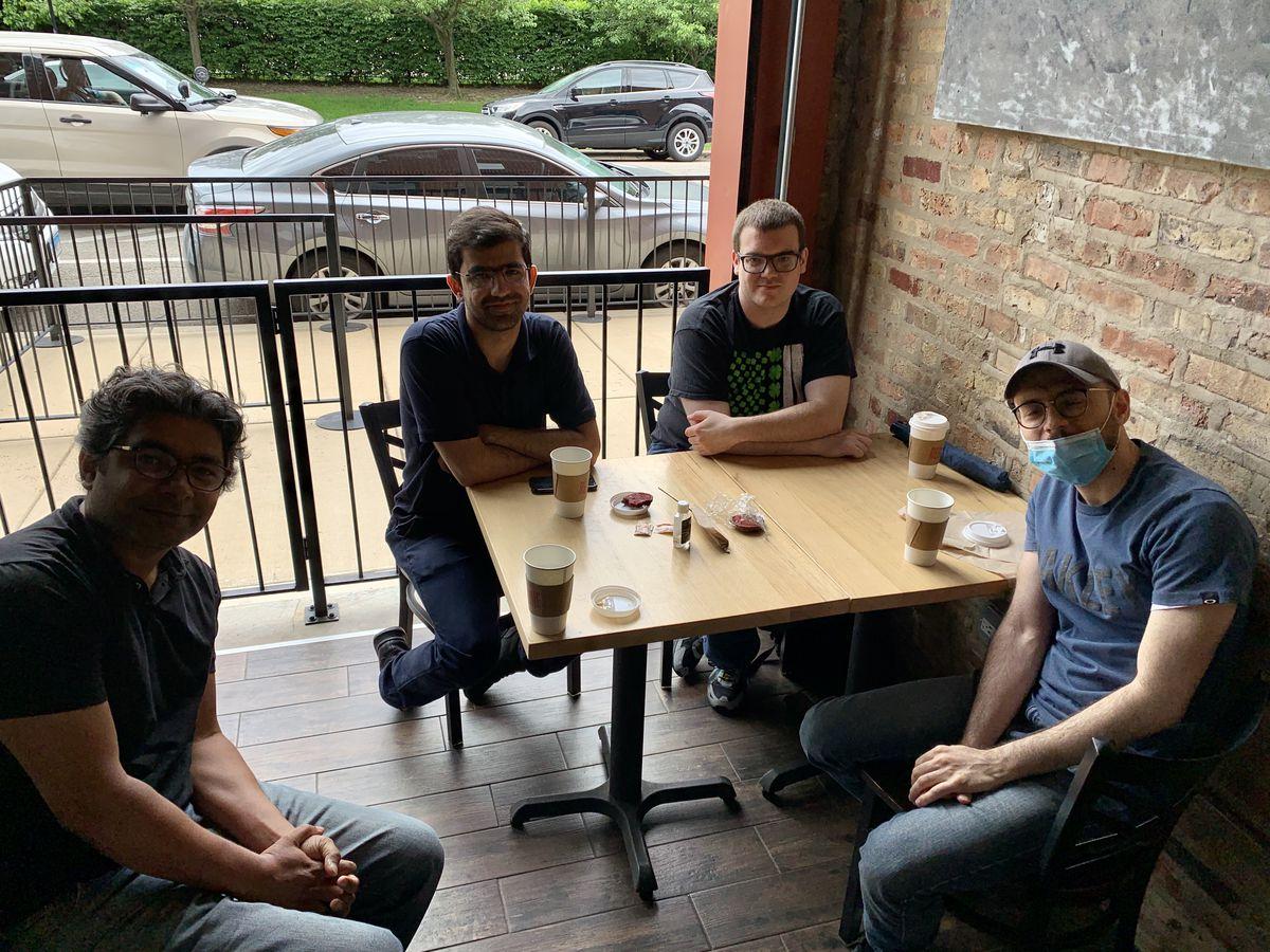 Ankit Srivastava, Hossein Khodavirdi, Declan Mulroy and Ashkan Mokhtari sit down for coffee Wednesday at the newly reopened Stix 'n Brix.