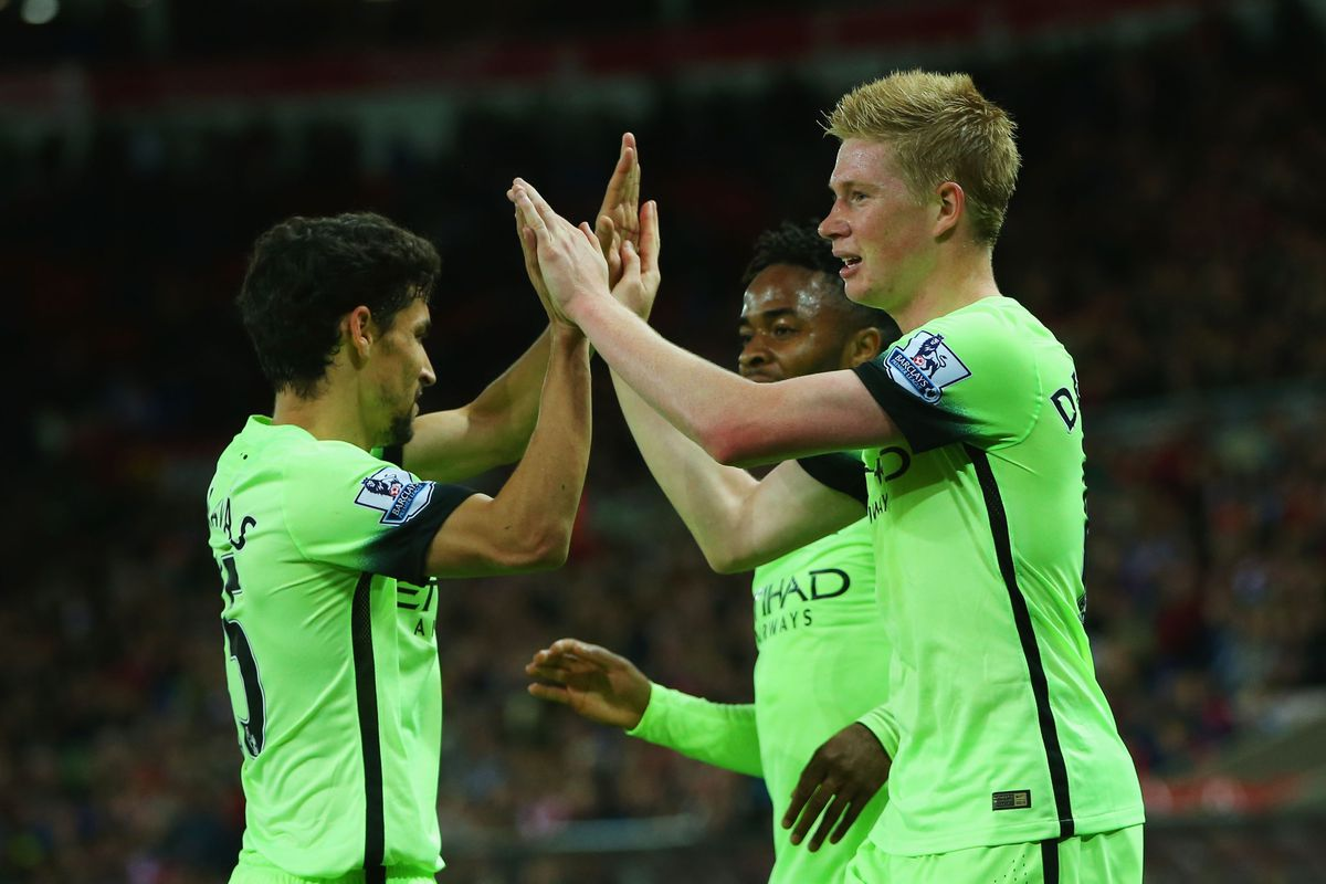 Sergio Aguero of Manchester City congratulates Kevin de Bruyne on scoring their second goal during the Capital One Cup third round match between Sunderland and Manchester City at Stadium of Light on September 22, 2015 in Sunderland, England.