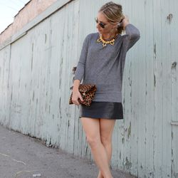 """Emily of <a href=""""http://cupcakesandcashmere.com/high-and-low/"""">Cupcakes and Cashmere</a> is wearing a Forever 21 sweatshirt, a Topshop skirt, a J.Crew necklace, <a href=""""http://www.shopbop.com/dorsay-flat-jenni-kayne/vp/v=1/1567671522.htm"""">Jenni Kayne</a"""