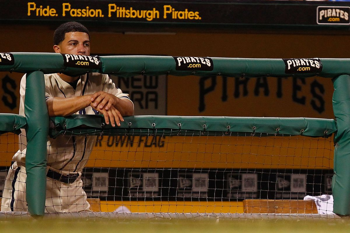 PITTSBURGH - JULY 23:  Xavier Paul #38 of the Pittsburgh Pirates stands in the dugout during the game against the St Louis Cardinals on July 23, 2011 at PNC Park in Pittsburgh, Pennsylvania.  (Photo by Jared Wickerham/Getty Images)