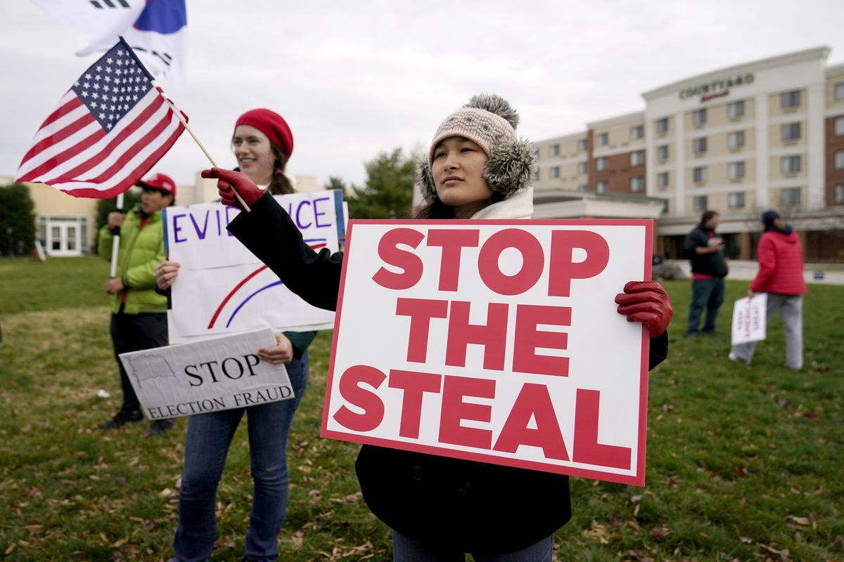 Supporters of President Donald Trump gather outside of the Wyndham Hotel where the Pennsylvania State Senate Majority Policy Committee is scheduled to meet, Wednesday, Nov. 25, 2020, in Gettysburg, Pa.