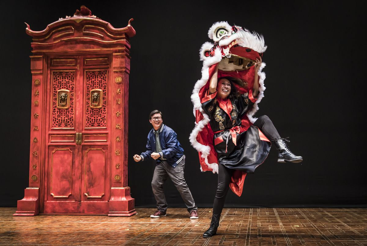 """Rammel Chan (left) and Angela Lin (as Lion dancer) in """"King of the Yees,"""" at the Goodman Theatre. 