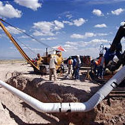 Questar Exploration and Production Co. workers install a 16-inch gas line on Pinedale Mesa.