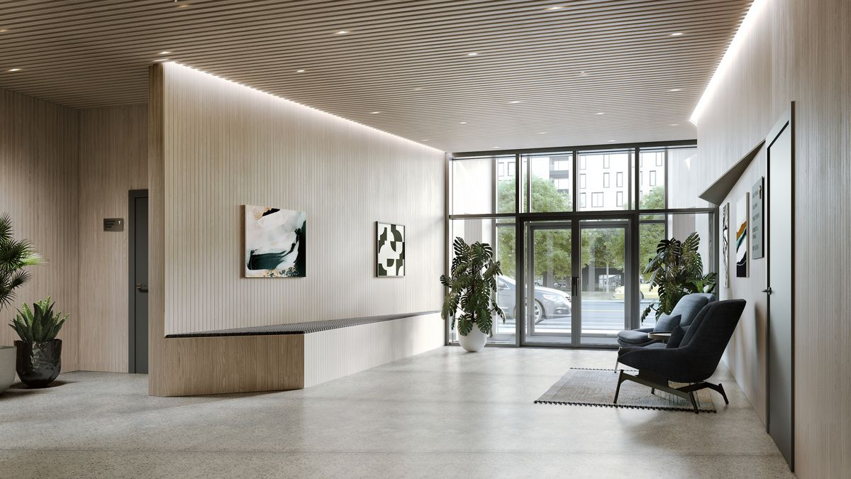 Rendering of an empty lobby. There's a big glass entryway leading to polished concrete floors and some seating. Recessed lighting in the ceiling.