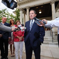 Gov. Gary R. Herbert talks with media outside the Governor's Mansion in Salt Lake City on Tuesday, June 28, 2016. Herbert defeated Jonathan Johnson in Tuesday's primary. With Herbert are his wife, Jeanette, Lt. Gov. Spencer Cox and Cox's wife, Abby.