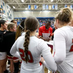 The Judge Memorial Bulldogs huddle during the last quarter of the 3A girls basketball semifinals at the Lifetime Activities Center in Taylorsville on Friday, Feb. 21, 2020.