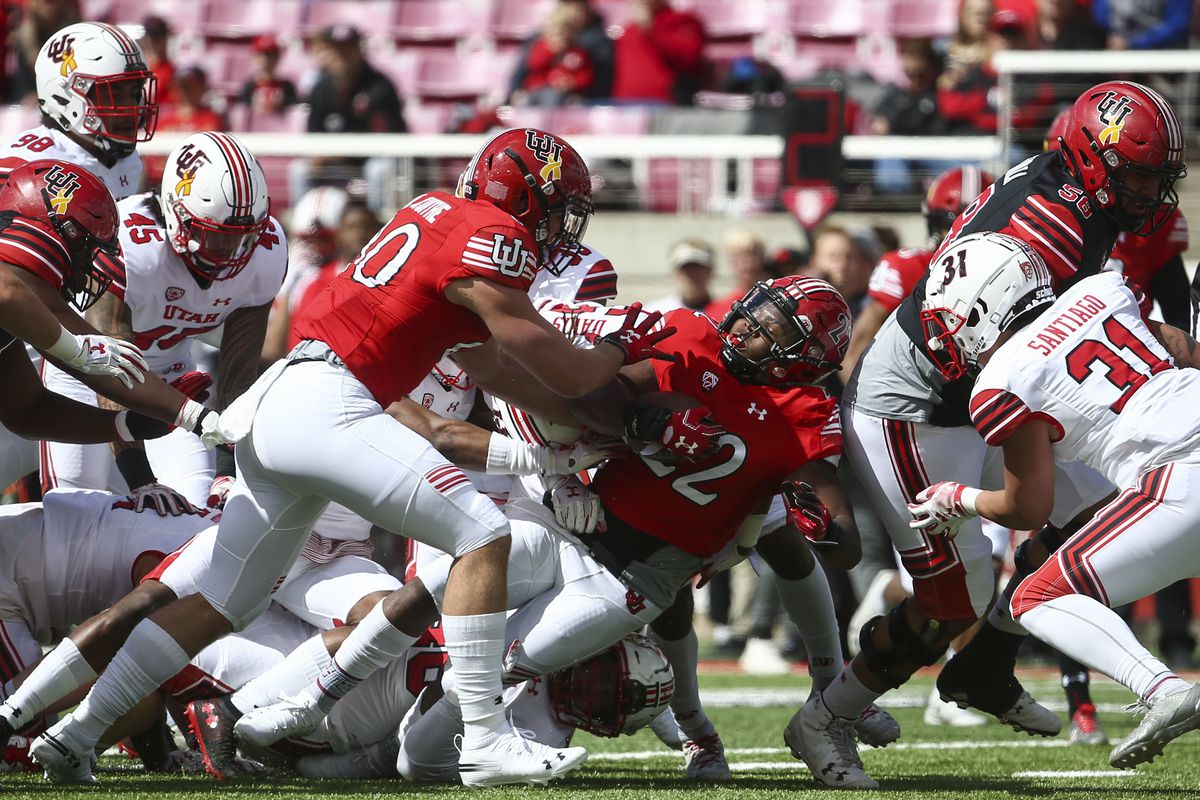 Utah Utes running back Devin Brumfield (22) is tackled while carrying the ball during the Red-White game at Rice-Eccles Stadium in Salt Lake City on Saturday, April 13, 2019.