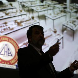 In this Wednesday, Sept. 19, 2012 photo, forensic anthropologist Thomas Holland speaks during a homicide seminar at the New York State Police Academy in Albany, N.Y. Holland helps attach names to unidentified remains, interpreting old bones that tell him their age when alive. He can tell height, gender, race and whether they were buried respectfully.
