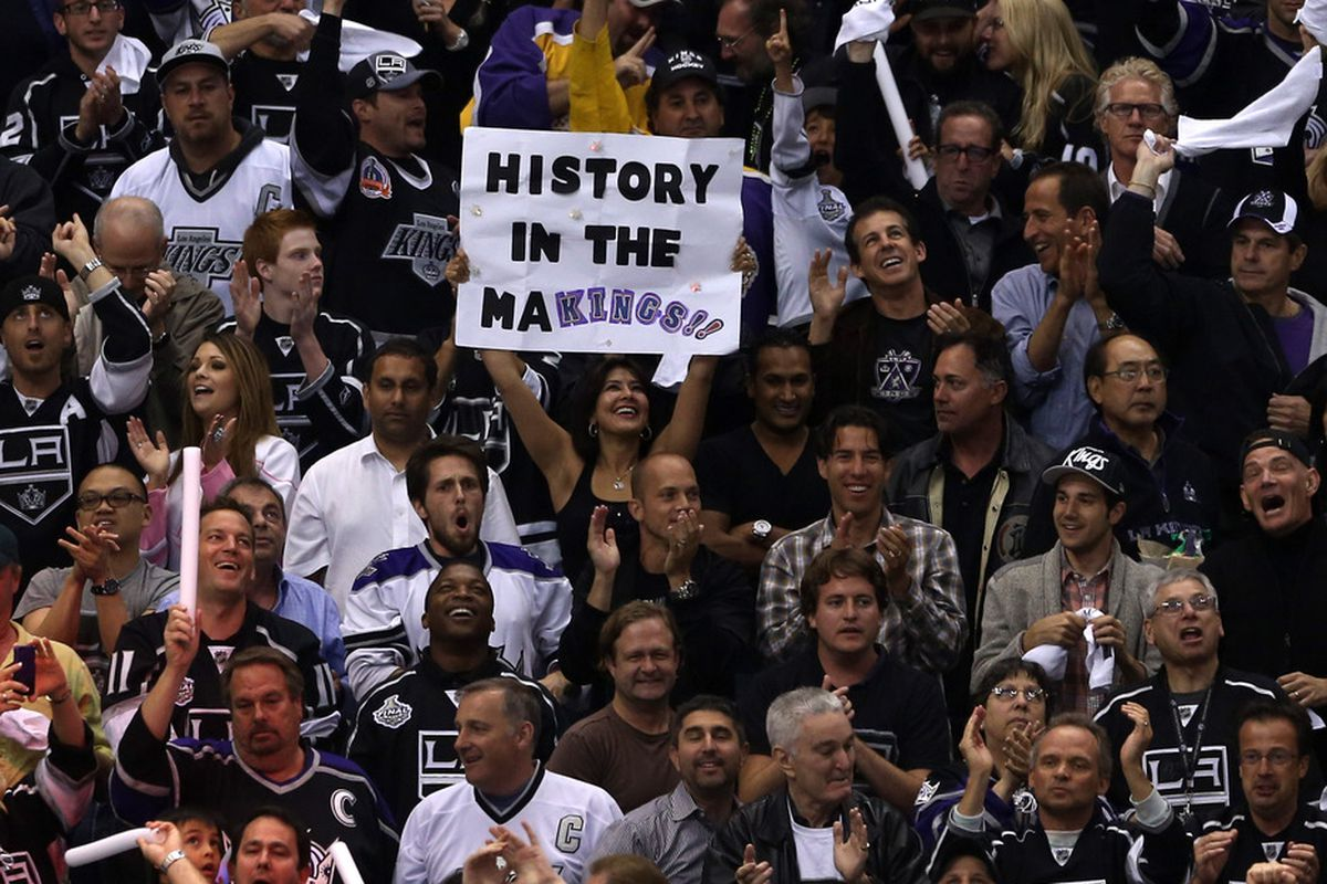 """LOS ANGELES, CA - JUNE 11:  A Los Angeles Kings fan holds up a sign """"History in the MaKings!!"""" in Game Six of the 2012 Stanley Cup Final at Staples Center on June 11, 2012 in Los Angeles, California.  (Photo by Bruce Bennett/Getty Images)"""