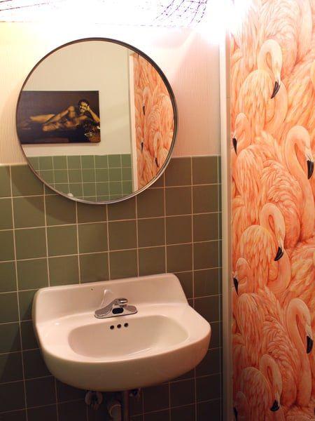 Burt Reynolds and flamingo wallpaper at Kitty Cohen's
