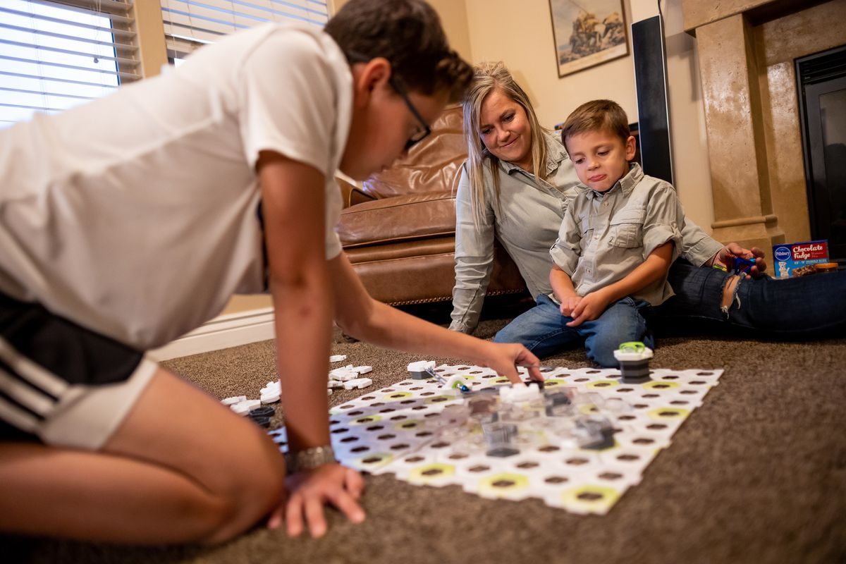 Ashley Felix plays with her sons Wyatt, 12, left, and Briggs, 4, at their home in Provo, Utah, on Tuesday, Oct. 5, 2021. Like many others in the 2021 American Family Survey, the Felix family had to juggle when schools closed and they also lost some income as businesses closed down.