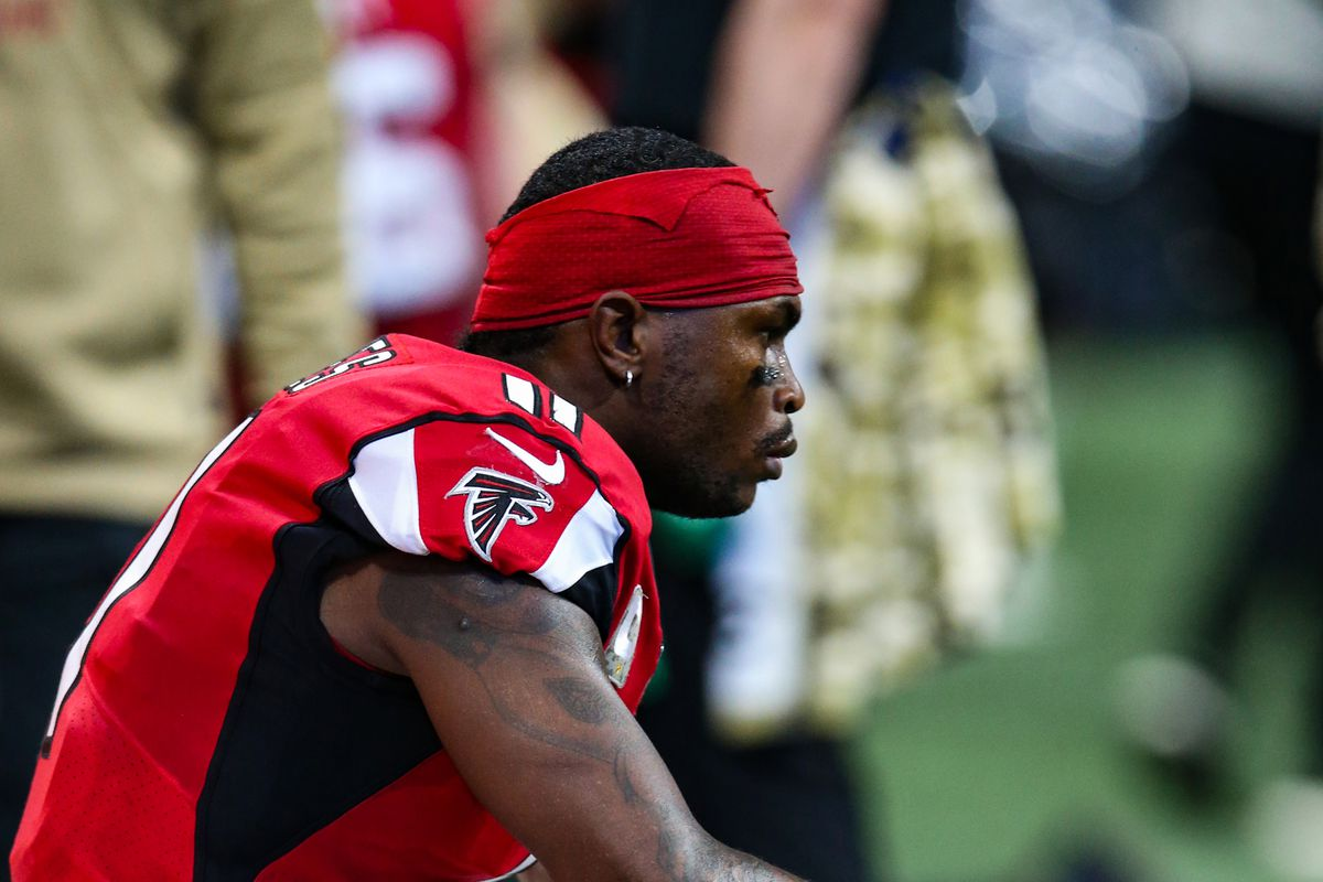 Julio Jones of the Atlanta Falcons looks on during the first half of a game against the Tampa Bay Buccaneers at Mercedes-Benz Stadium on November 24, 2019 in Atlanta, Georgia.