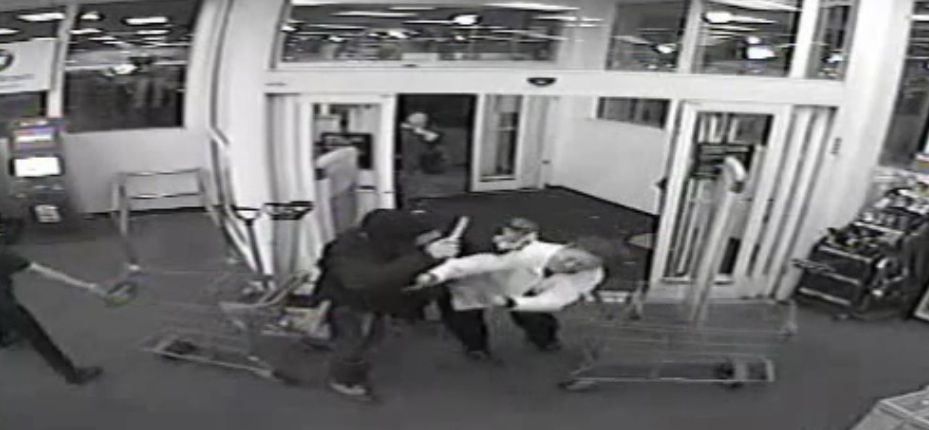 Surveillance video shows a person holding an object while tussling with an employee at a North Side CVS before a fatal police-involved shooting in February 2017.   Independent Police Review Authority