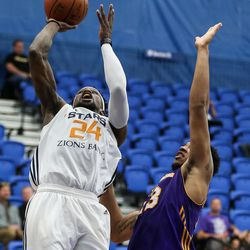 Salt Lake City Stars guard Jermaine Taylor (24) lays it up over Los Angeles D-Fenders forward Justin Harper (23) at the Lifetime Activities Center in Taylorsville on Wednesday, Feb. 08, 2017.