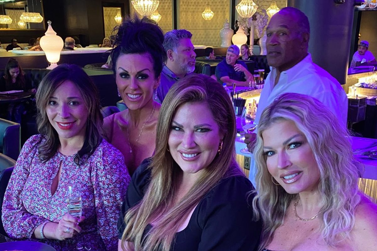 """OJ Simpson photo bombs a photo of """"Real Housewives of Orange County"""" Emily Simpson and friends at Jing on Thursday."""