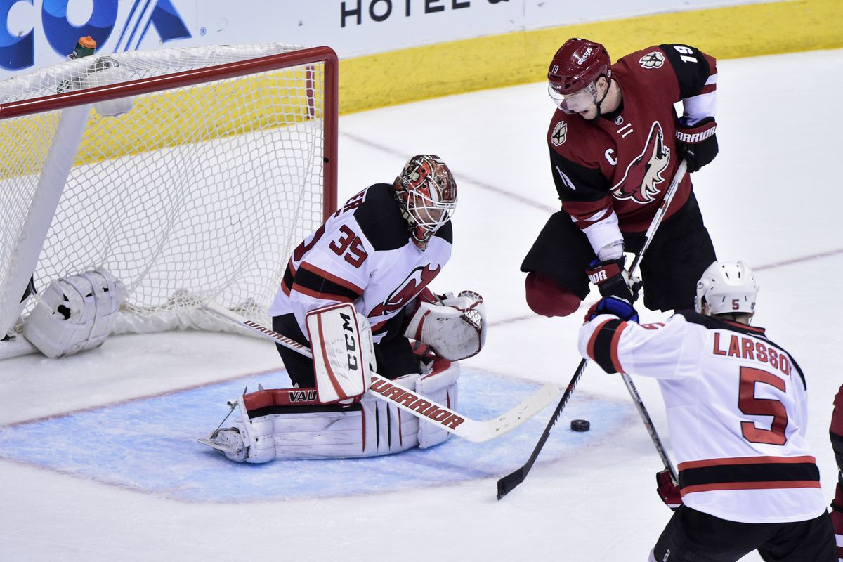 Here, Schneider is ruling while the Devils aren't defending.  Notice nobody is on Shane Doan.  Schneider bailed them out again!