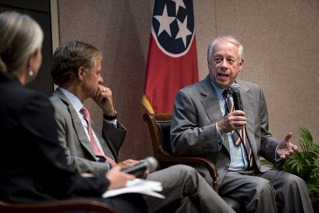 Former Tennessee Gov. Phil Bredesen speaks as his successor, Gov. Bill Haslam, listens during a 2017 forum.