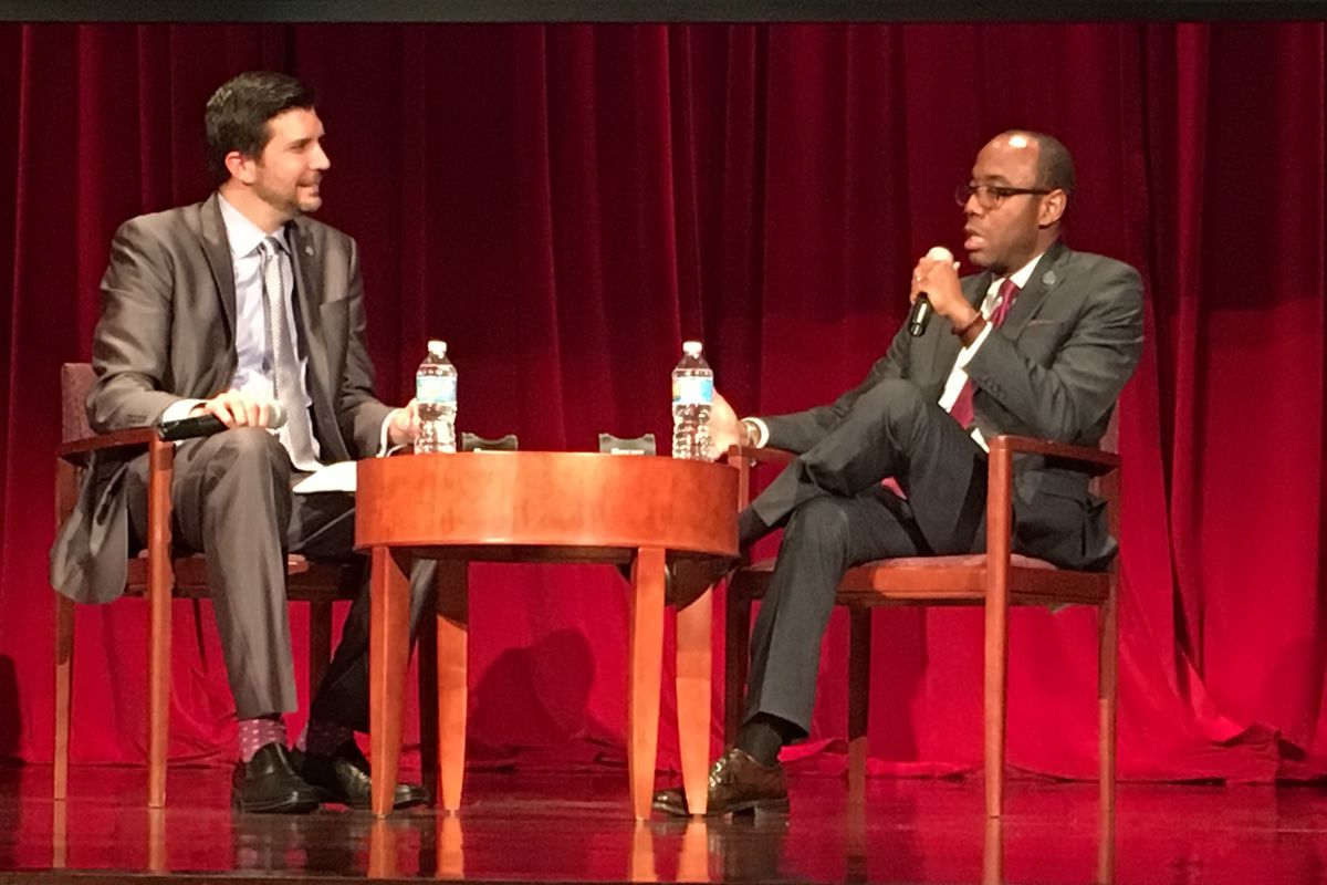 NAACP President Cornell Brooks (right) talks with the Presidio Institute's David Smith at NYU Wednesday night.