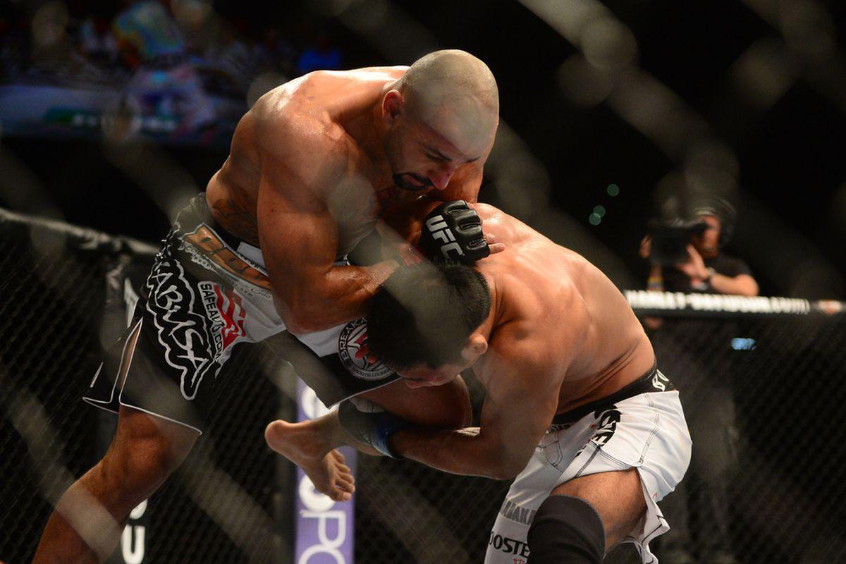 Jul. 7, 2012; Las Vegas, NV, USA; UFC fighter Constantinos Philippou (top) battles Riki Fukuda during a middleweight bout in UFC 148 at the MGM Grand Garden Arena. Mandatory Credit: Mark J. Rebilas-US PRESSWIRE
