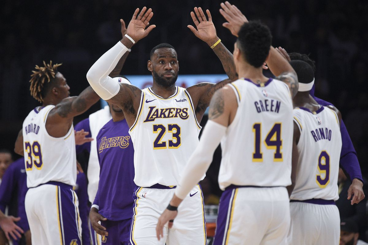 Los Angeles Lakers forward LeBron James celebrates with his team after a time out is called during the second quarter against the Atlanta Hawks at Staples Center.