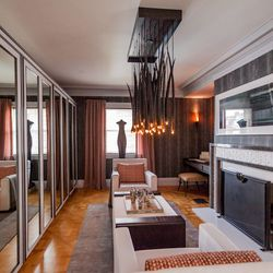 """The master sitting room was designed by Zoe Hsu of <a href=""""http://z-dimensions.com/"""">Z Dimensions Interior Design</a>. One of the many highlights was the Gemsbok Horn Chandelier, which demands your attention when you enter the room. [Photo by <a href=""""ht"""