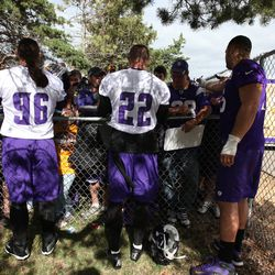 Jul 26, 2013; Mankato, MN, USA; Minnesota Vikings defensive end Brian Robison (96), safety Harrison Smith (22) and offensive tackle Matt Kalil (75) sign autographs for fans during training camp at Minnesota State University. Mandatory Credit: Brace Hemmel