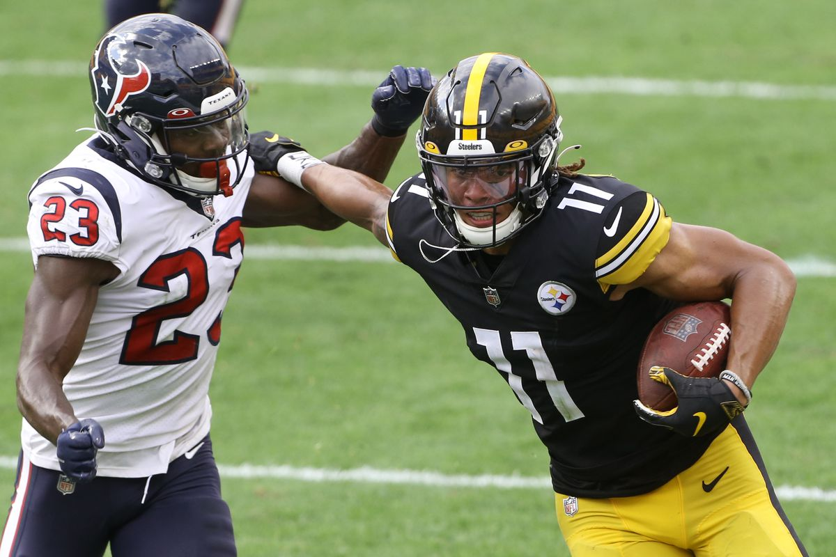 Pittsburgh Steelers wide receiver Chase Claypool (11) runs after a catch as Houston Texans free safety Eric Murray (23) defends during the fourth quarter at Heinz Field.