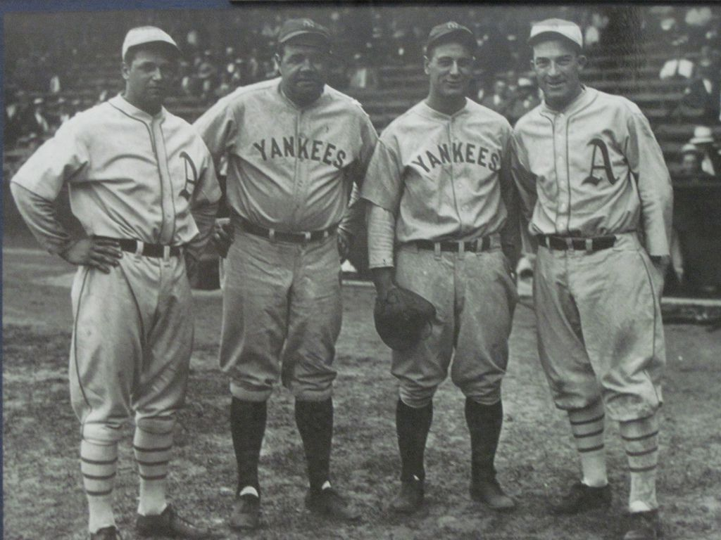 Jimmie Foxx, Babe Ruth, Lou Gehrig, and Mickey Cochrane (left to right) photographed at Shibe Park in 1937.
