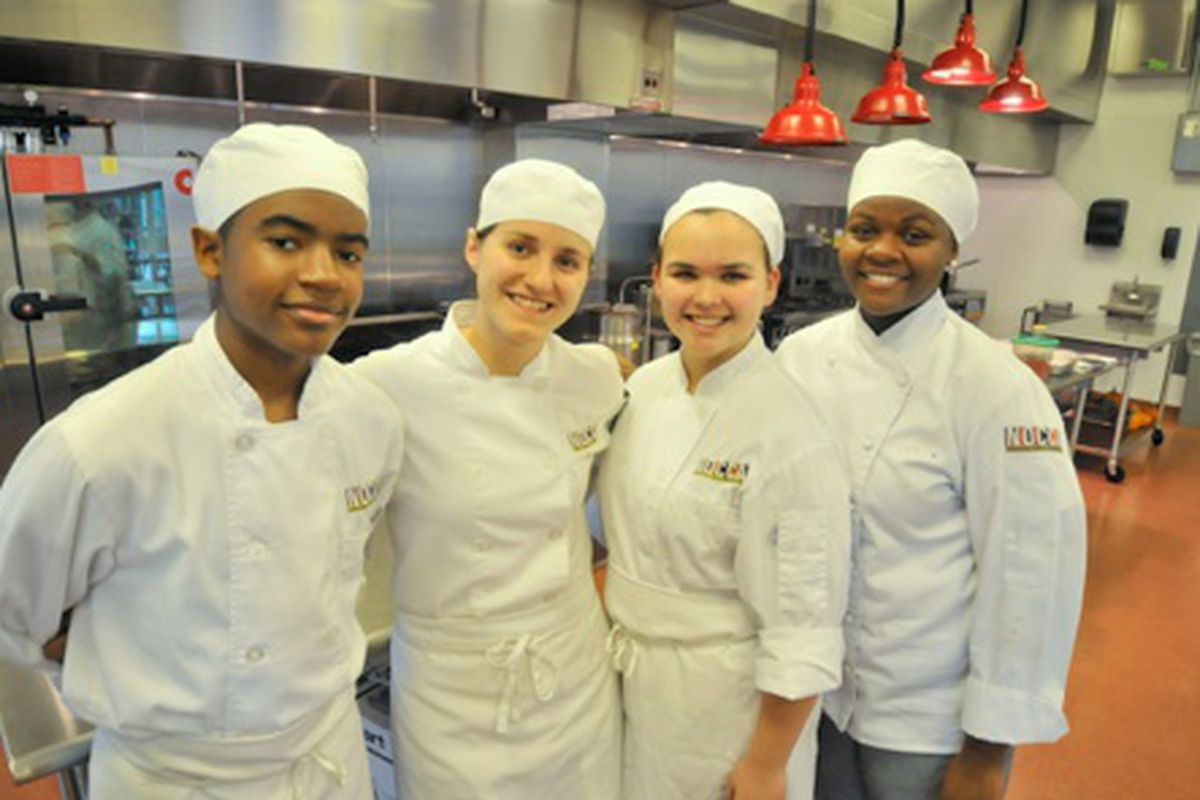 Janée Taylor (right) with other students in the NOCCA kitchen.