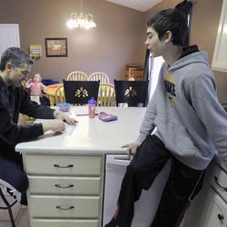 Jeff Griffin talks with his son Bradley, 12, in the kitchen before dinner in their home in West Jordan on Thursday, Feb. 27, 2014.
