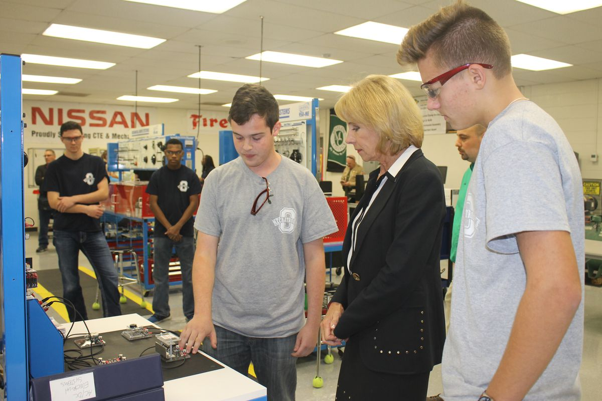 Secretary of Education Betsy DeVos talks with students during a 2017 tour of career and technical education programs at Oakland High School in Murfreesboro, Tennessee.