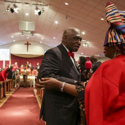 Rev. France Davis greats Rosette Rwamiitigo as he finishes the service at Calvary Baptist Church in Salt Lake City on Sunday, Dec. 22, 2019. Rev. Davis is planning to retire at the end of the year after having been pastor of the church since 1974.