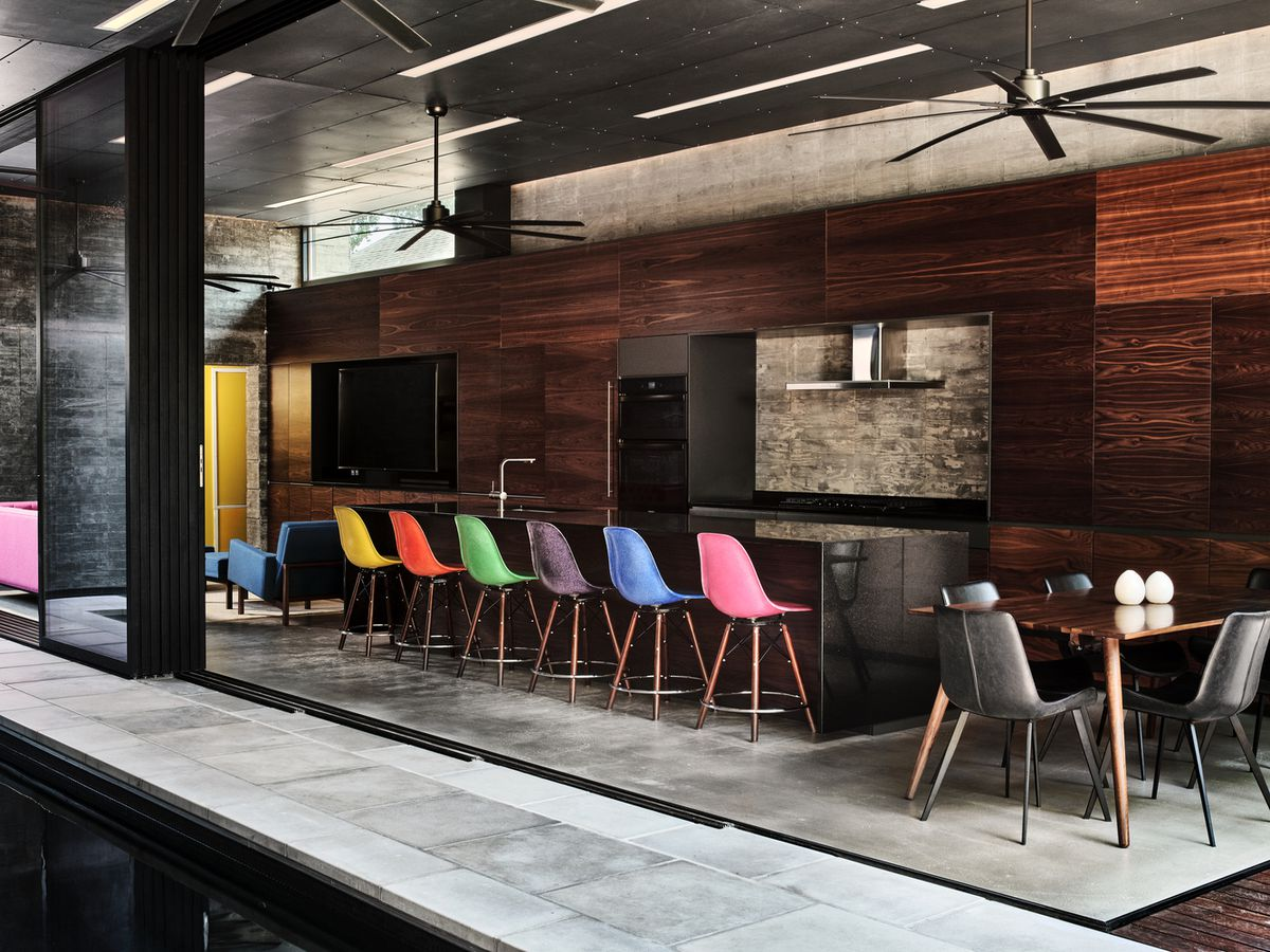 Colorful chairs lined up at breakfast bar in kitchen
