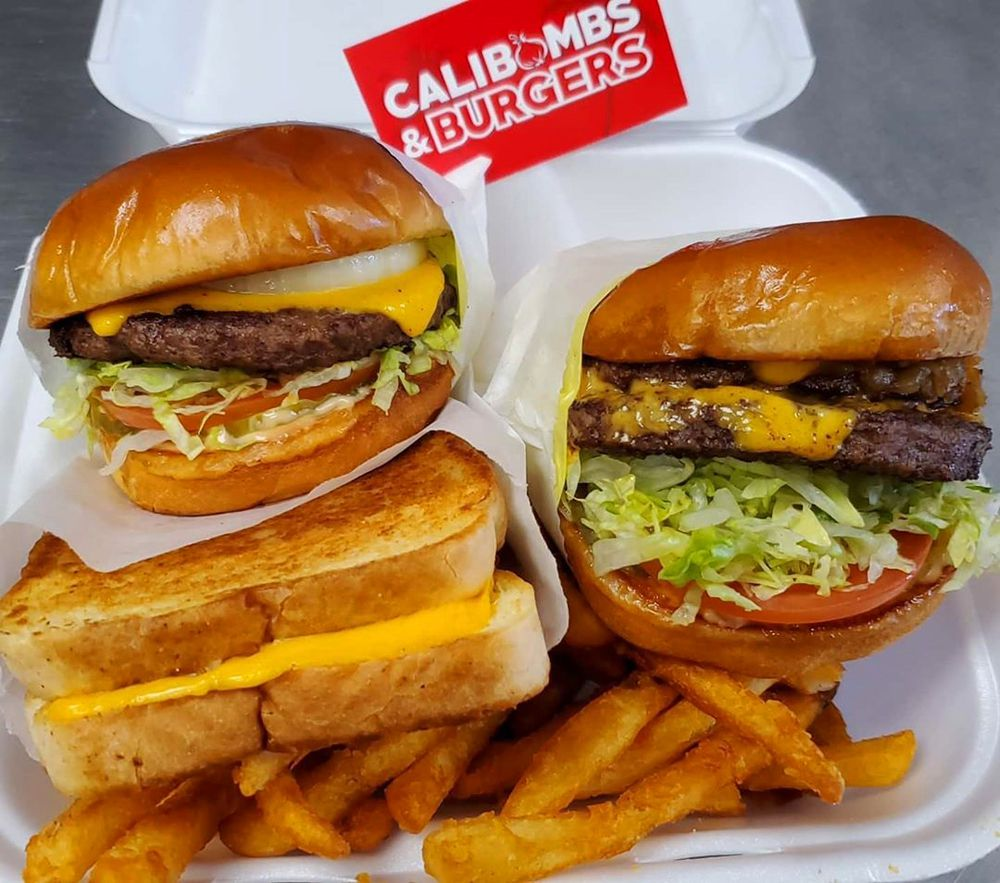 Cali Cali burgers with grilled onions and a grilled cheese sandwich on Texas toast at CaliBombs & Burgers