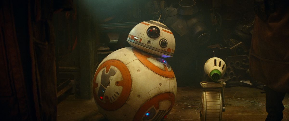 Globe-shaped, orange-and-white droid BB-8 and cone-headed green-and-white droid D-O look at the camera in a shot from The Rise of Skywalker.