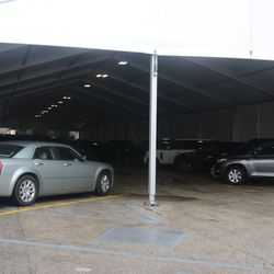 Cars in the VIP/Players parking lot -