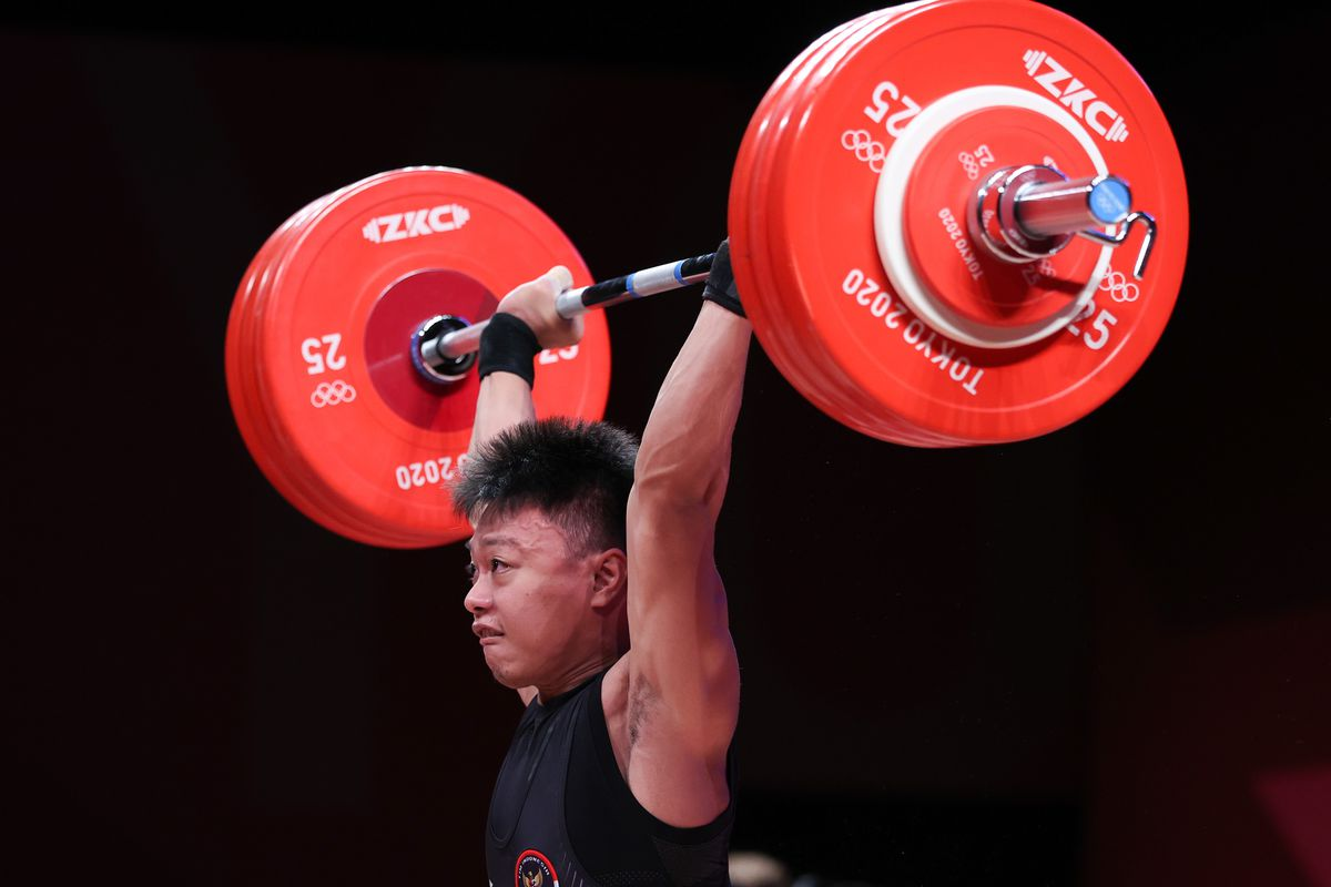 Rahmat Erwin Abdullah of Indonesia competes during the men's 73kg weightlifting event of the Tokyo 2020 Olympic Games in Tokyo, Japan, July 28, 2021.