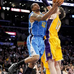 New Orleans Hornets forward Lance Thomas (42) gets by Los Angeles Lakers forward Pau Gasol (16), of Spain, for a basket in the first half of an NBA basketball game on Saturday, March 31, 2012, in Los Angeles. (AP Photo/Gus Ruelas)